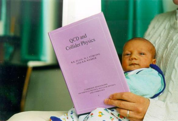 James Stirling baby boy reading QCD and Collider Physics book.jpg
